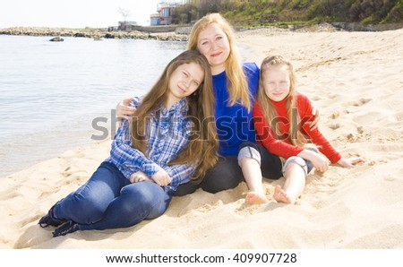 Family mother with two daughters on beach, recorded in Saint Constantine and Helen resort, Bulgaria. - stock photo