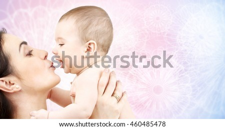 family, motherhood, parenting, people and child care concept - happy mother kissing adorable baby over rose quartz and serenity patterned background