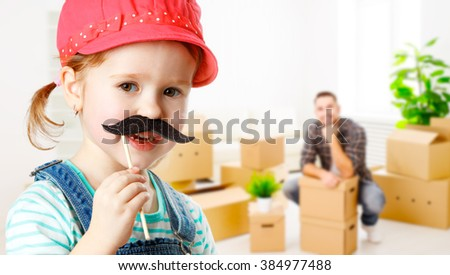 family moving home and renovation. funny child girl with a mustache foreman and father - stock photo