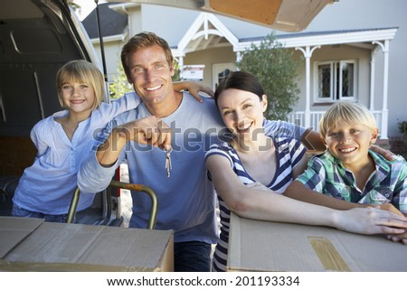 Family moving house - stock photo