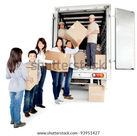 Family moving house taking boxes into a truck - isolated over a white background - stock photo