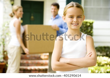 Family moving into their new home - stock photo