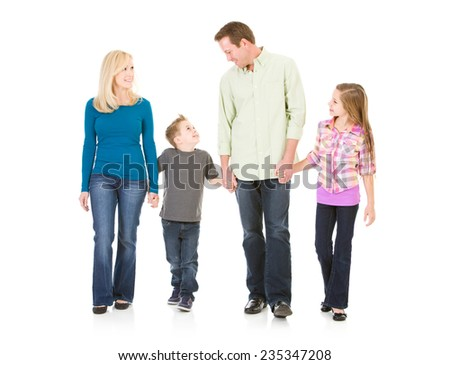 Family: Nuclear Family Parents And Kids Walk Holding Hands - stock photo