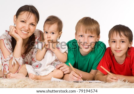 family of a four lying on a carpet
