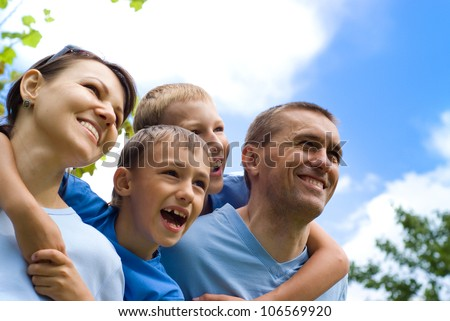 family of a four playing at nature - stock photo