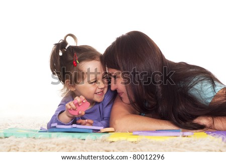 family of a two playing on carpet