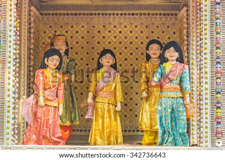 Family of beautiful puppets in a puppet show operated using strings.