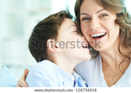 Family of ecstatic mother and son laughing