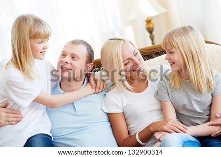 Family of four enjoying spending time together - stock photo