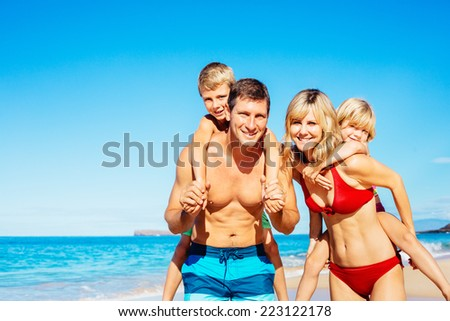Family of Four Having Fun on Tropical Beach in Hawaii - stock photo