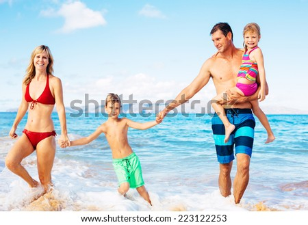 Family of Four Having Fun on Tropical Beach in Hawaii