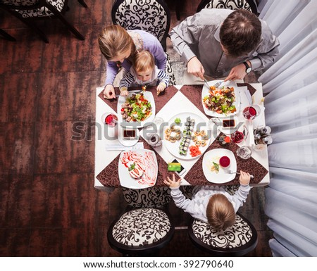 Family of four having meal at a restaurant