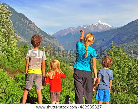 Family of four in mountains