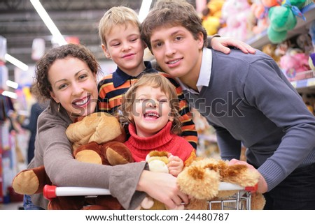 Family of four in shop with toys