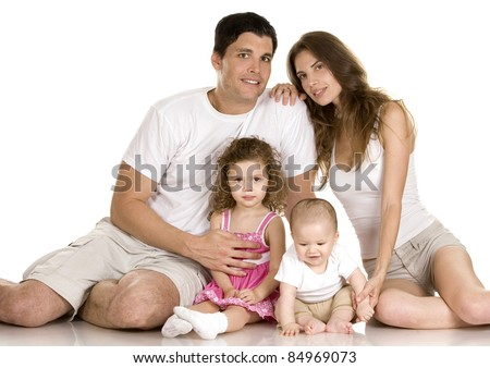 family of four in the studio having fun together - stock photo