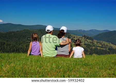 Family of four looking at the beautiful view