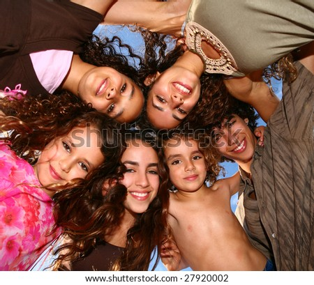 Family of 6 Happy Kids Looking Down Smiling Outdoors