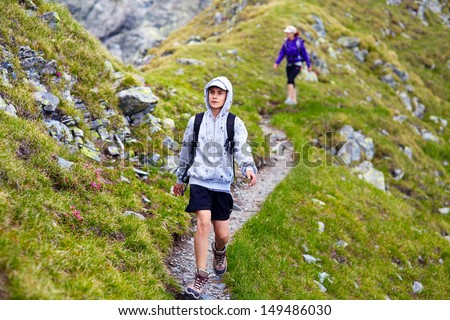 Family of hikers - mother and son, on a mountain