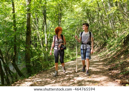 Family of hikers on a trail in the beech forest