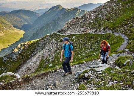 Family of hikers on a trail in the rocky mountains - stock photo