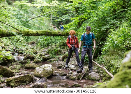Family of hikers walking through a beautiful canyon - stock photo