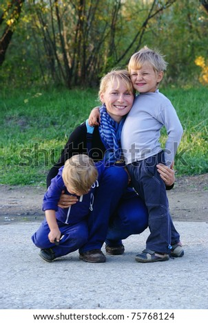 Family of mother and two sons in casual clothes