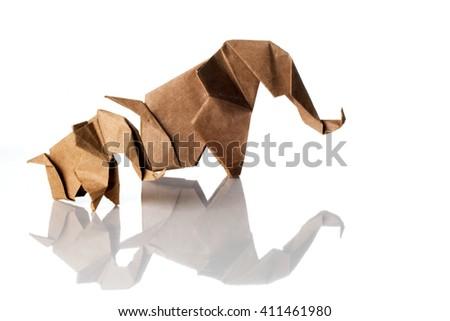 Family of origami elephants isolated on white background - stock photo