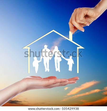 Family of parents and two children inside a house - stock photo