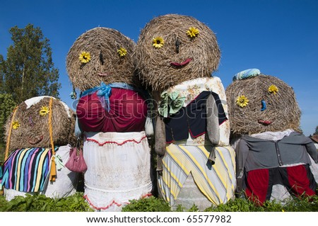 family of straw puppet