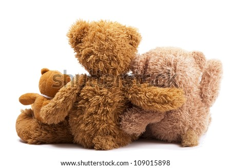 Family of teddy bears holding in one's arms - stock photo