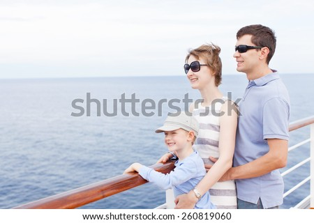 family of three enjoying vacation at cruise ship - stock photo