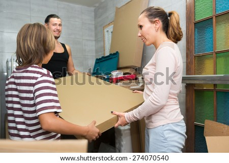 Family of three people preparing to repair in a new apartment - stock photo