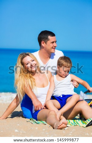 Family of three person on the beach