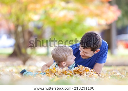 family of two at fall time - stock photo
