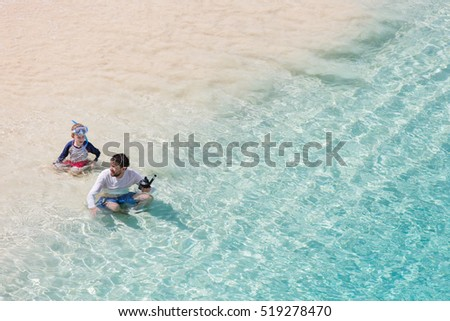 family of two enjoying snorkeling at caribbean vacation, active and healthy lifestyle