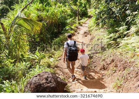 family of two hiking the kalalau trail at kauai island, hawaii - stock photo
