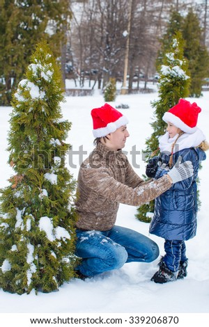 Family of two on skating rink outdoors at beautiful summer day - stock photo