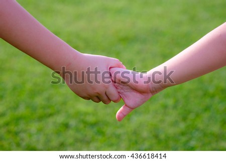 Family, Older sister and younger sister walking hand in hand in the garden, Trust and help concept. idea use for background.
