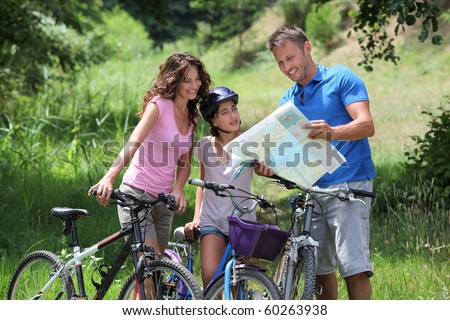 Family on a bicycle ride - stock photo