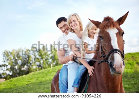 Family on a horse - stock photo