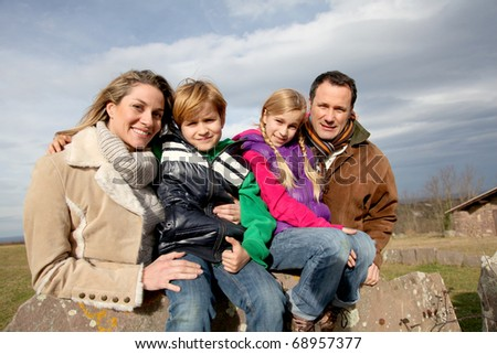 Family on a walk day in the countryside - stock photo