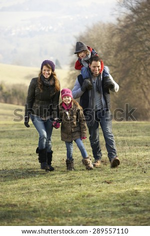 Family on country walk in winter - stock photo