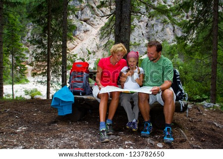 Family on hike, Family planning mountain trek - Dolomites - Italy - stock photo