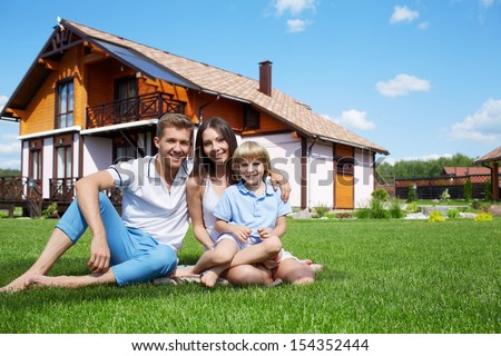 Family on lawn at home