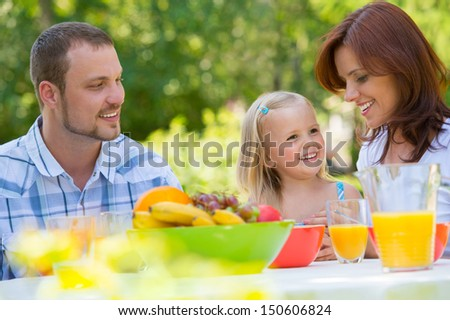 Family on picnic at park or backyard - stock photo