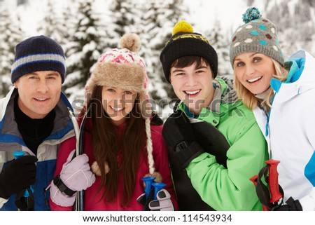 Family On Ski Holiday In Mountains - stock photo