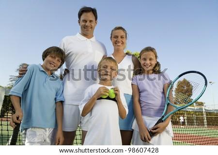 Family on Tennis Court - stock photo