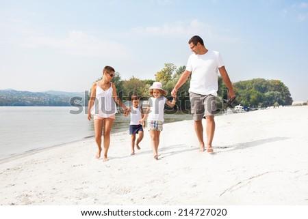 Family on the beach - stock photo