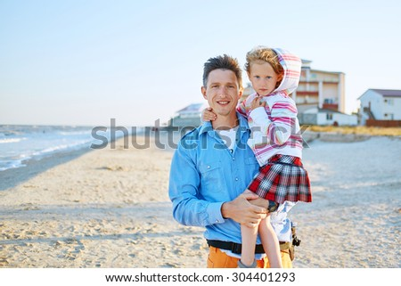 family on the beach at the  sunset