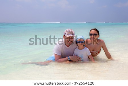 Family on the beach of Maldive Island